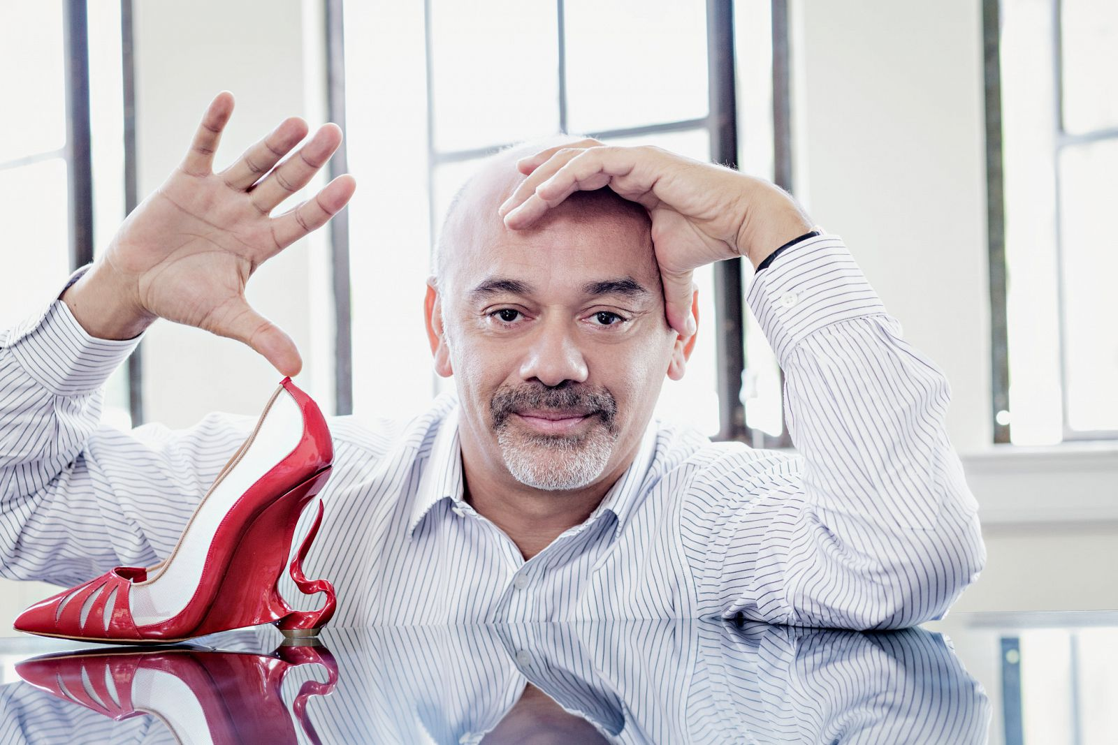 net worth of christian louboutin